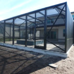 black metal pool enclosure and screen